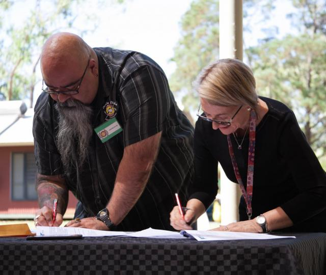 Danila Dilba acting CEO Malcolm Darling and CAAPS CEO Jill Smith signing of the  MOU agreement between Danila Dilba and CAAPS