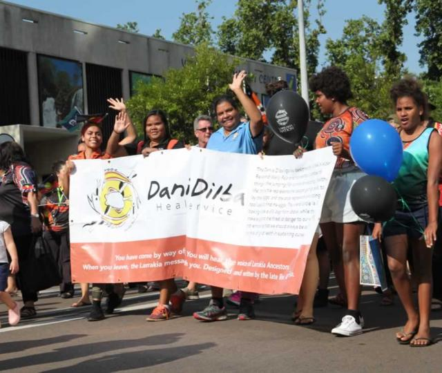Danila Dilba staff marching proudly  at the 2018 NAIDOC march.